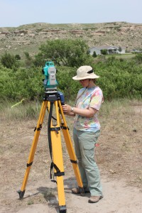 Sarah running a total station at 14SC409